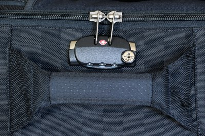 Three digit Samsonite TSA lock for main compartment is built in to the side of the bag, just near the carry handle.