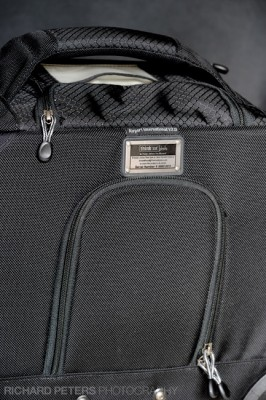 Rear lock concealed behind a zipped flap on the Airport International v2.0 bag