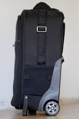 The right hand side has a strap that doubles as both a tripod holder and a handle to lift the bag.