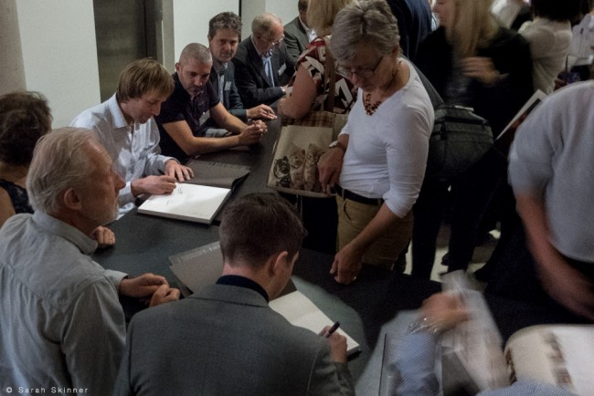 Photographers book signing during the RGS event